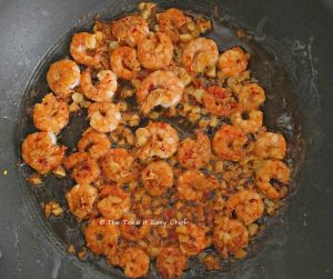 Turn the prawns over and fry on the other side