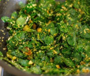 Moringa Leaves Stir-Fry Steps Image - Moringa leaves added to the pan and mixed well