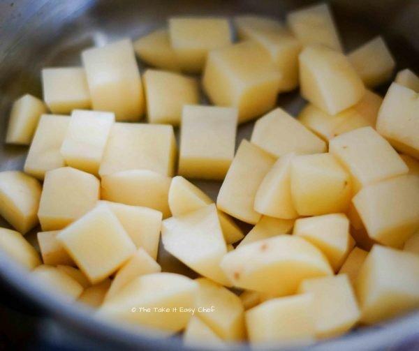 Cook and mash potatoes