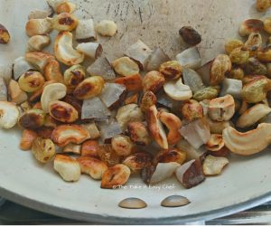 Cashews, raisins and coconut chips fried till golden brown