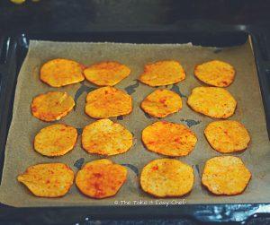 Seasoned sweet potato slices ready to bake