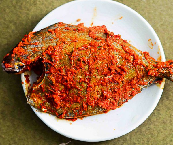 Fish coated with marinade ready to fry