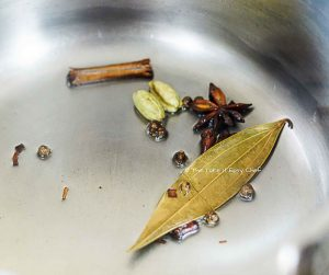 Fry the whole spices in some oil