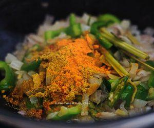 Add turmeric powder and coriander powder