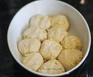 Arrange the coated balls in the baking dish for the Pull Apart Cheesy Garlic Bread