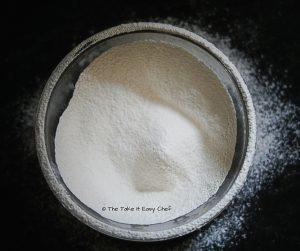 Flour sieved for the Pull-Apart Cheesy Garlic Bread