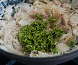 Add the green chilli paste to onions