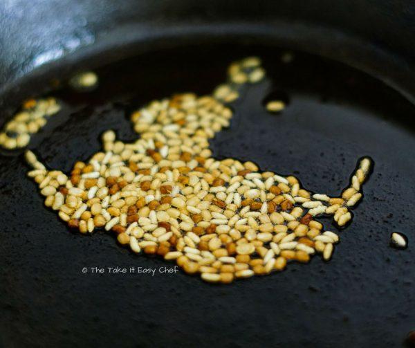 Bangda Uddamethi Steps - Fry the rice, fenugreek seeds, and urad dal