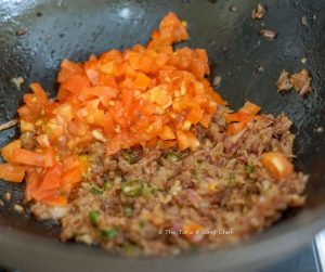 Keema Paratha Step picture- Adding chopped tomato