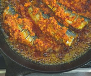 Thalassery Style Sardine Fry Steps - Extra marinade added to the pan