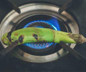 Vazhuthananga Udachathu (Roasted Brinjal Eggplant Aubergine Kerala Style) Steps - Roasting on a flame
