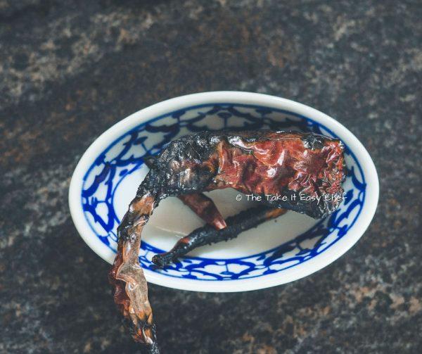 Vazhuthananga Udachathu (Roasted Brinjal Eggplant Aubergine Kerala Style) Steps - Dry chillies are also roasted