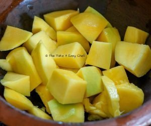 Mambazha Pulissery Steps - Mangoes are peeled and sliced